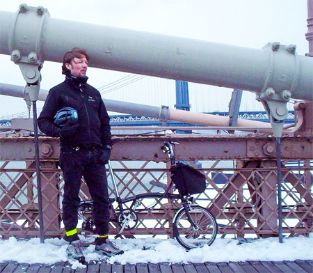 Sketchblog artist Harold Graves with his Brompton T-6 folding bike on the Brooklyn Bridge.